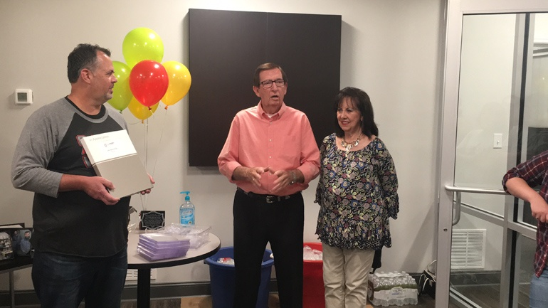 employee receiving recognition at Years of Service presentation
