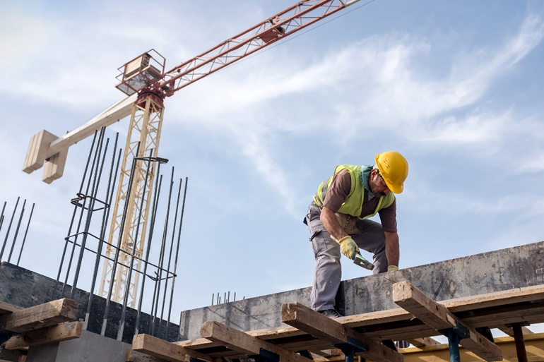 construction worker on top of building with crane over head may not be OSHA compliant