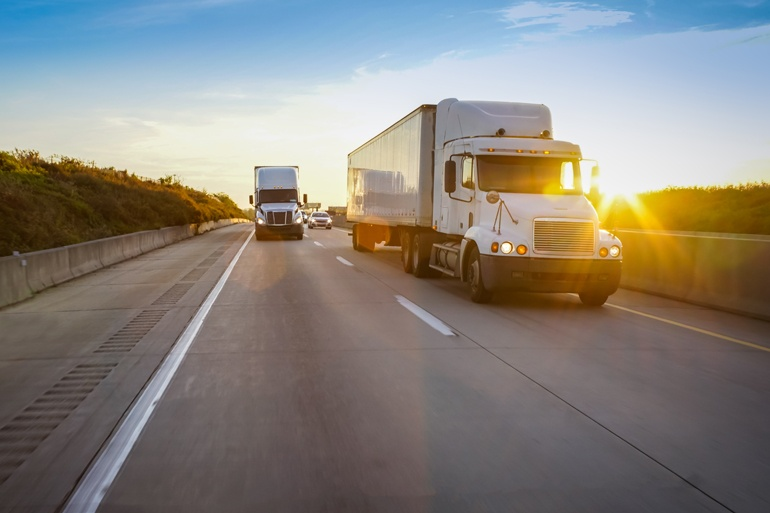 freight trucks on the highway during National Truck Driver Appreciation Week