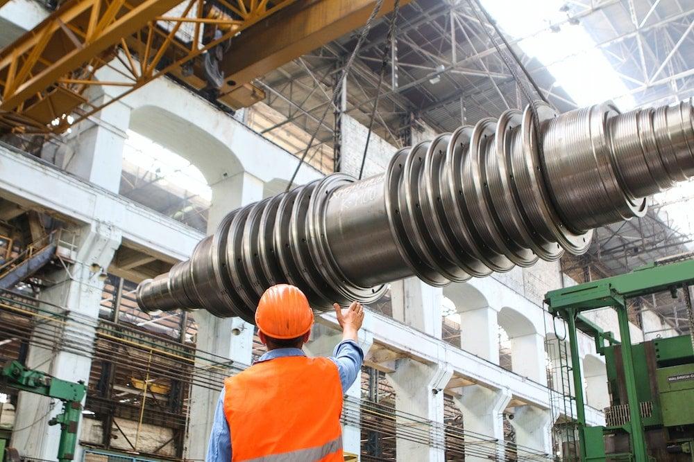 man-standing-beside-heavy-equipment-2760242
